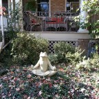 meditating from yard statue